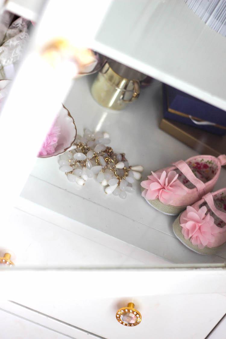 white storage cabinet in nursery
