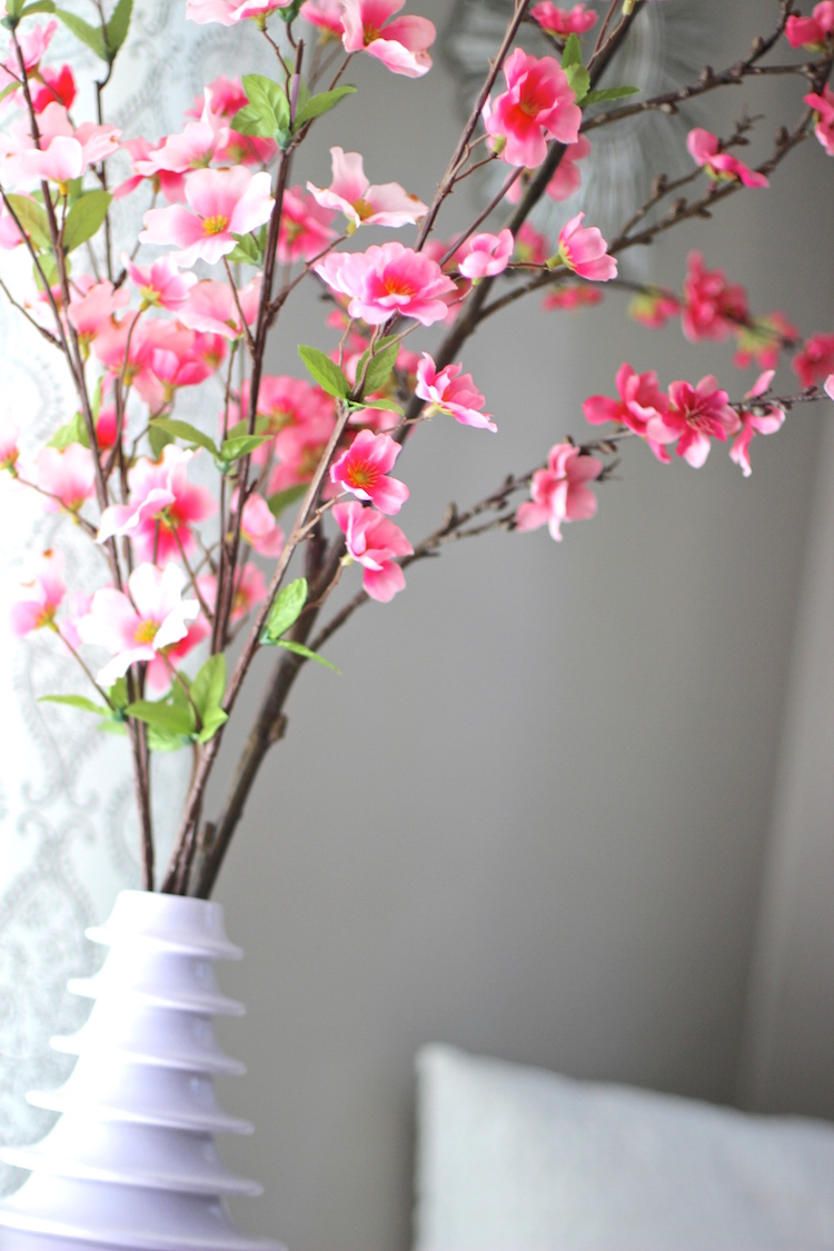My favorite thing we added to our bedroom are these faux cherry blossom stems. Little secret.. I mixed a couple kinds of flowers - one branch cost $12 and the others were $2!! Can you tell?
