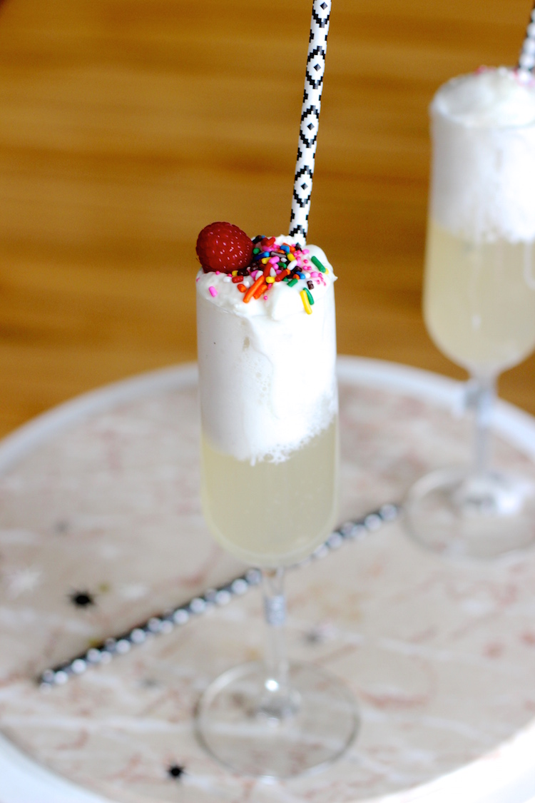 Combining my 3 favorite treats to make these delicious champagne floats - champagne, sprinkles and ice cream!