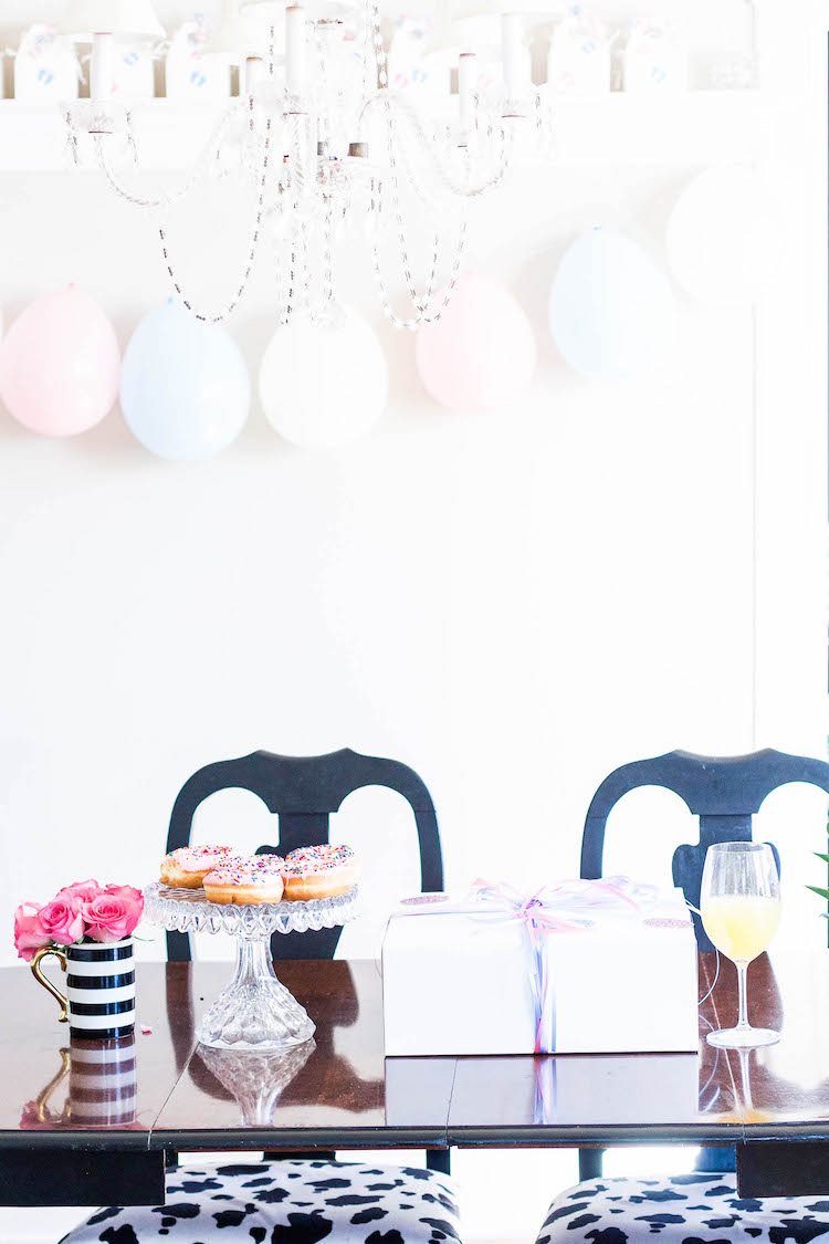 Pink and blue balloons, flowers and donuts - Just a sneak peek of some of our gender reveal party for baby #2!
