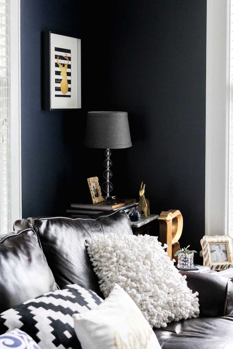 "A mix of navy blue walls, zebra rug, eclectic items and a TV way too large for the space. I tend to break those ""design rules"" in my home. It's one place I can experiment and play!"