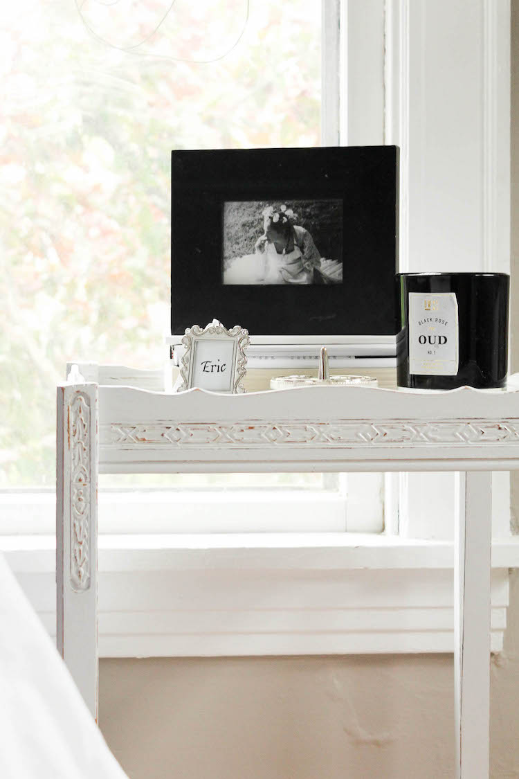 """See the little frame that says """"Eric""""? This may sound silly but we each have one on our bedside tables (mine says """"Sam"""" of course ;)). They were actually given to us as gift tags on a bridal shower gift we received. I loved them so much and had to keep them in! Thanks Cindy!"""
