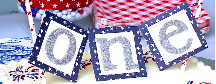 "DIY banner cake topper - Taylor was born on the Fourth of July which gives us an easy and fun party theme for her birthdays. For her 1st birthday last year, I made her a cake topper that says ""ONE"" and you can make this say anything really.  It was so easy that I had to share the details!"