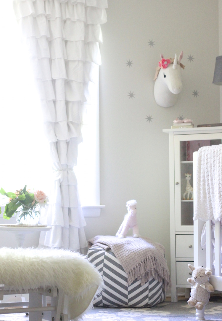 We finally hung a few things in Kinzie's nursery and although it is not completely finished, I had to share a couple things I love about it! It's filled with floral accents, unicorns, and playful items. Whimsical and serene. A great mix for a baby!