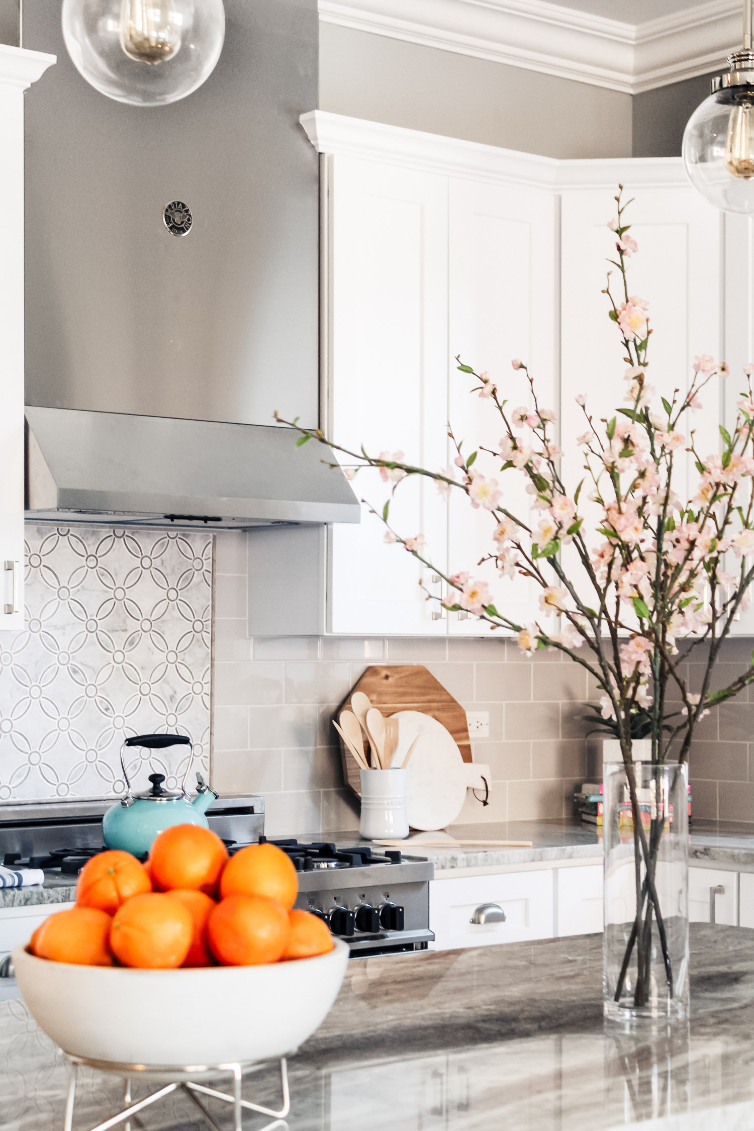This was my first project where I was able to select finishes and it was for a condo going on the market to sell. Even though it sold right away (without it being styled btw), I wanted to see this kitchen look a little lived in before saying goodbye.