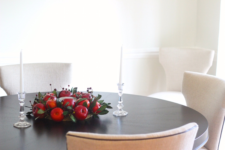 3. As a centerpiece. With a candle in the middle.... I used a short candle here but a tall one would look fabulous too. Just make sure to choose a candle that is a good fit (and color) for the center. The trick here is to make it look like one piece so you don't want a lot of empty space in the middle. If you need to, fill that space with extra leaves or something that goes with the style of your wreath :)