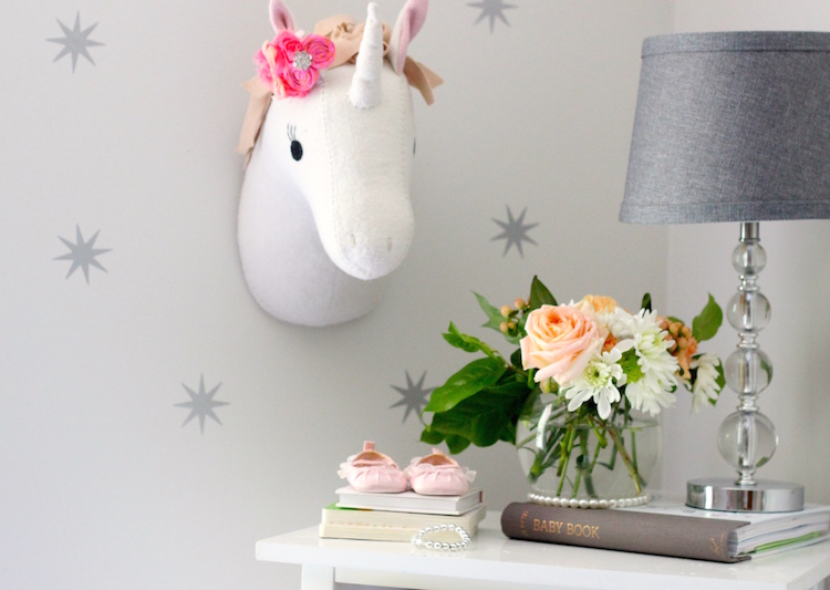 How cute is this unicorn? I originally bought it for our gallery wall in the playroom but it looks much better here. It's from the Pillowfort line at Target - which is full of fun items for kids rooms. I dressed ours up with a pretty bow and some stars (my mom's idea!). We were between this unicorn and the one at Land of Nod. Both are adorable!