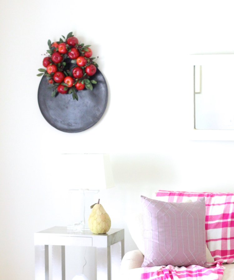 4. Over your wall decor. Dress up your wall decor with a wreath. From frames, to artwork. Think of adding a wreath as just another layer! And we all need a few extra layers as the temps get cooler..