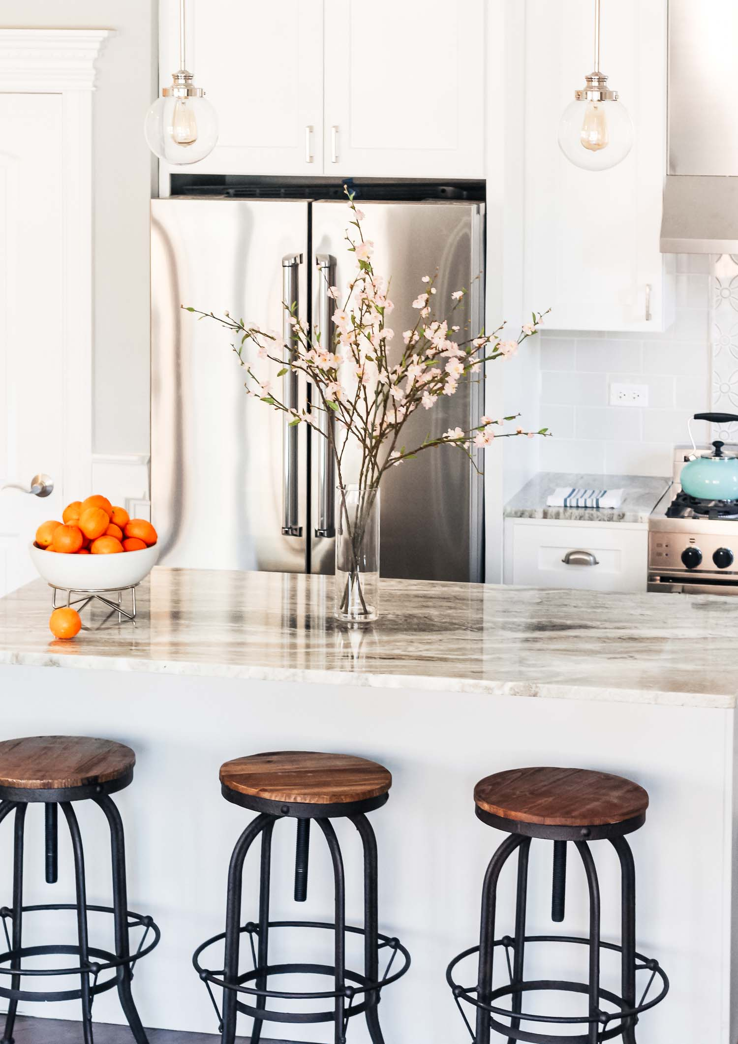 Since this condo was going on the market, the design needed to appeal to a variety of buyers. My goal was for the space to feel beautiful and classic, with a modern touch. Which pretty much sums up my design aesthetic! Sometimes a little eclectic and industrial too but I love mixing traditional, modern and vintage finds to create a timeless space.