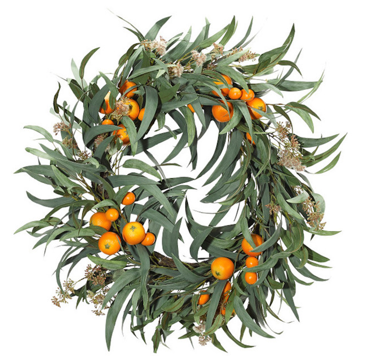 This Eucalyptus and Orange Wreath is unique and fresh! See more of my favorite wreaths on the Holiday Wreath Round Up!