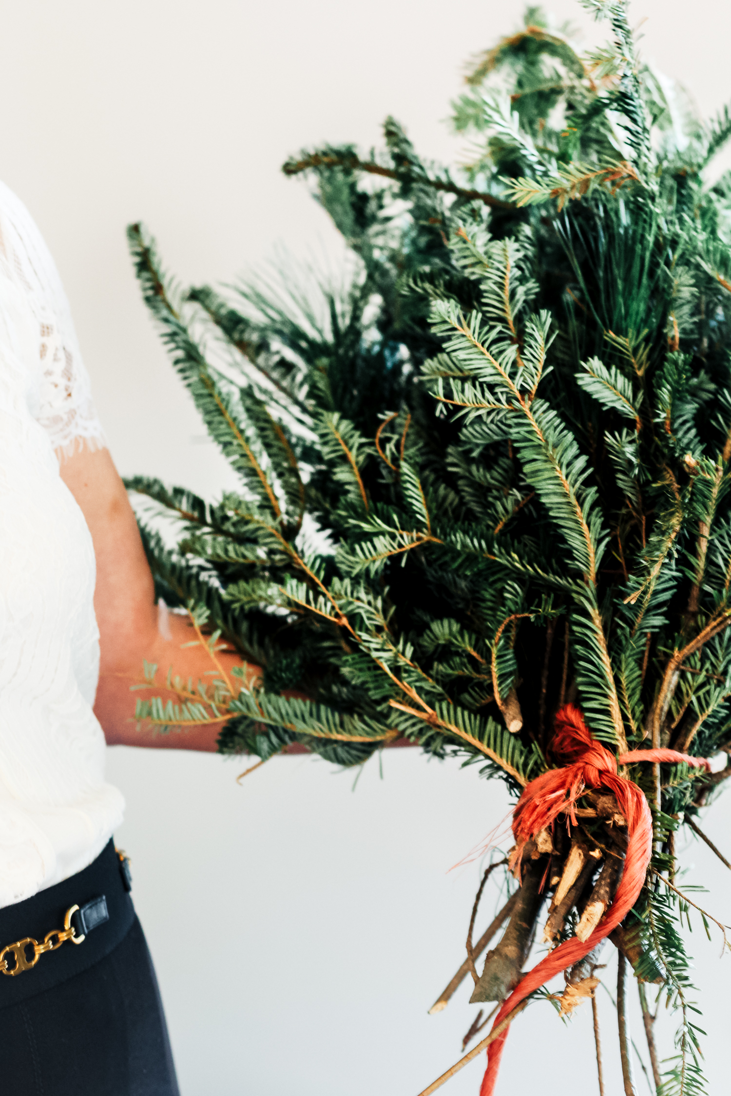 """Add some spruce! Use fresh greenery in vases, bowls or even baskets. This is an easy way to decorate and a great way to add in the smell of a real tree if you have a fake one! Look to your garden or Christmas tree to clip fresh greenery. I bought this """"leftover"""" bundle at the garden center to make it even easier this year."""