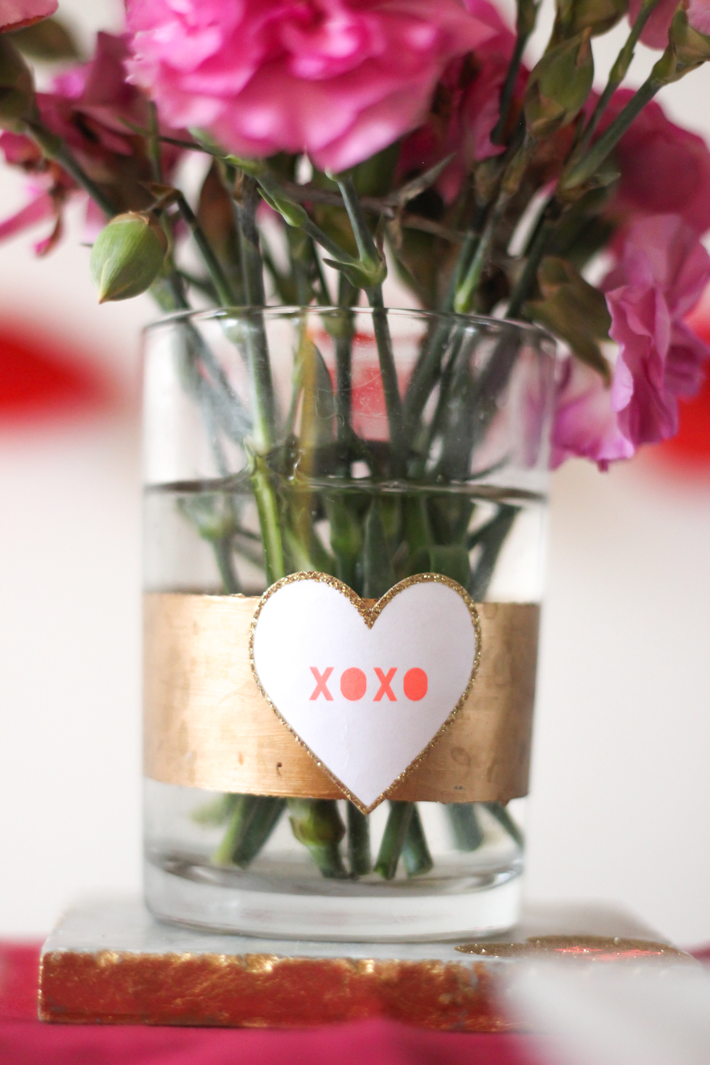 I used an old vase that I painted a gold strip on and then added some Valentine's day stickers. The flowers from Trader Joes we had leftover from last week. Still going strong! Love when that happens.