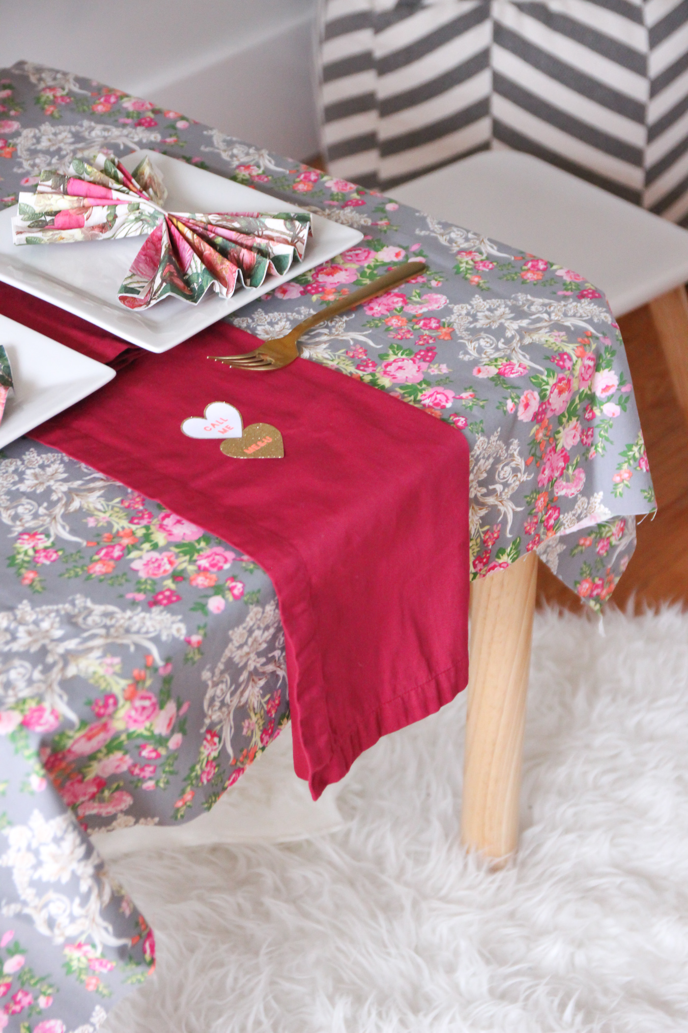 We started by clearing out the dining room to make room for Taylor's table since it was a little more exciting than the everyday table (glad Eric didn't mind!). The tablecloth is actually just a fabric remnant from another project. I thought I would have a pillow made but the size turned out to be perfect for this tablecloth.