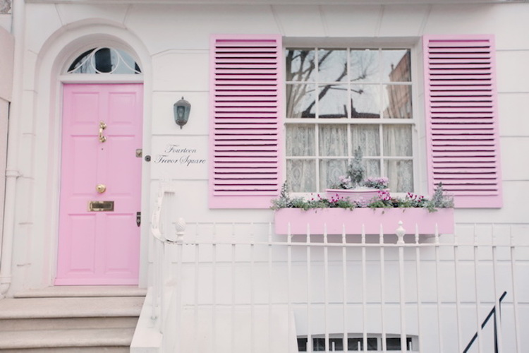 The Cherry Blossom Girl found this house, with pink shutters and a pink planter box to match the door.