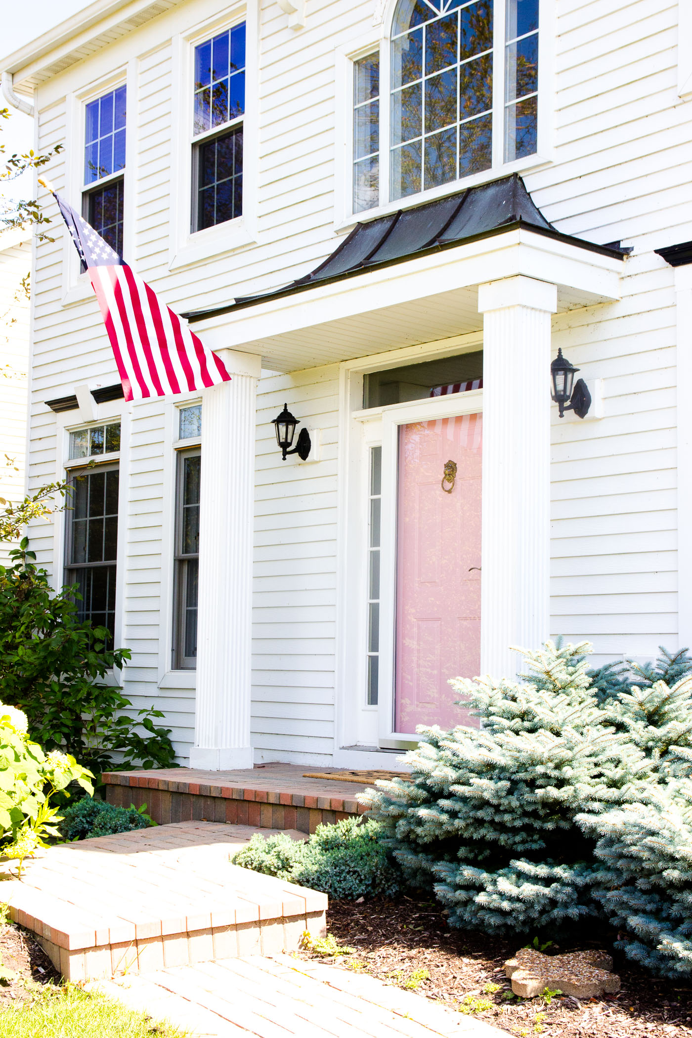 I love every time I pull up to our house and see our beautiful pink door. It just makes me so happy. And that's what a home should do.