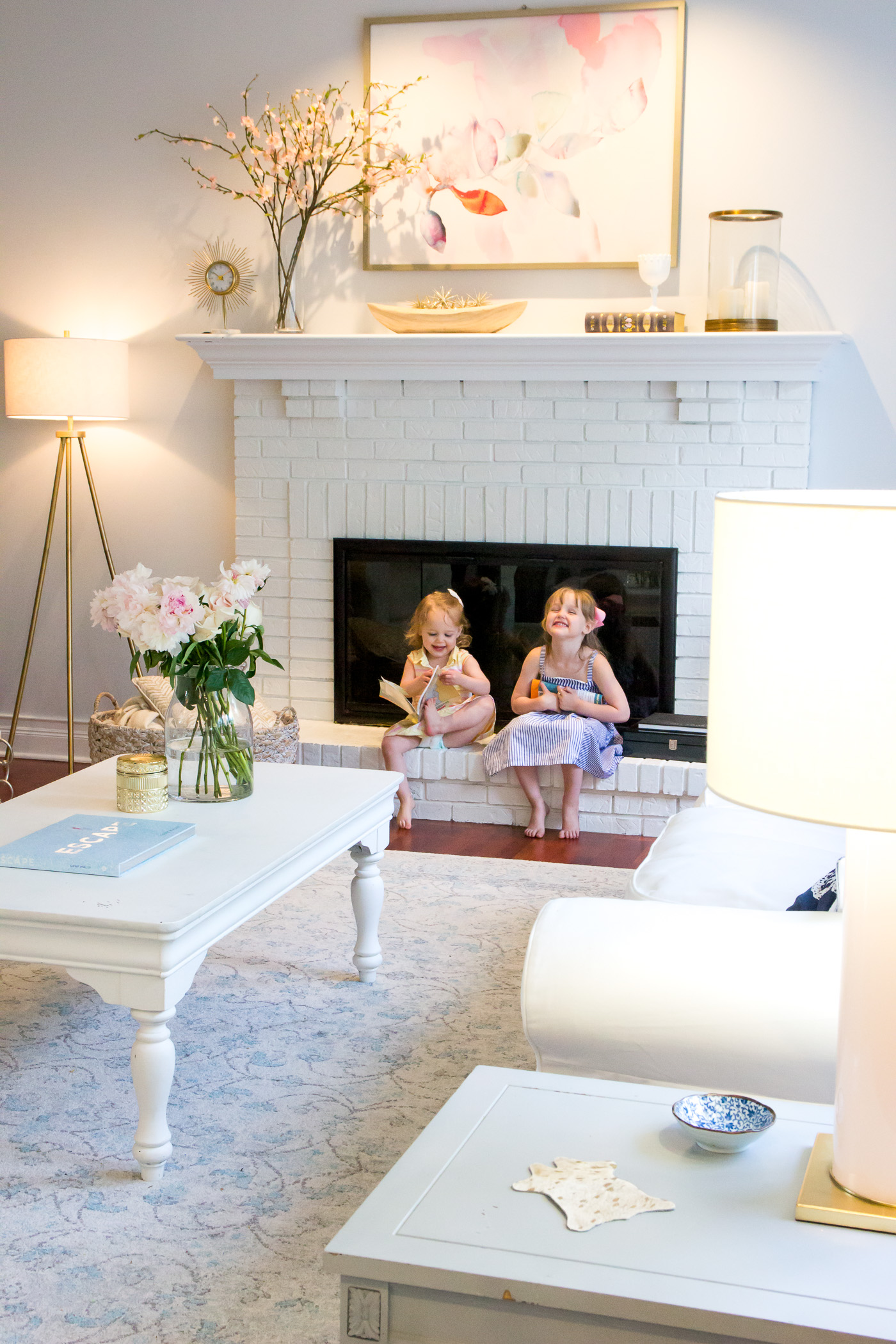 You can see more photos of our living room here during the day in this post and without that stylish changing table next to the fireplace that i tried to